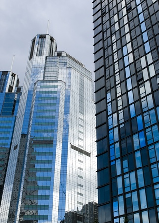 Highrise glass building with sky and clouds reflection Stock Photo - 17414346