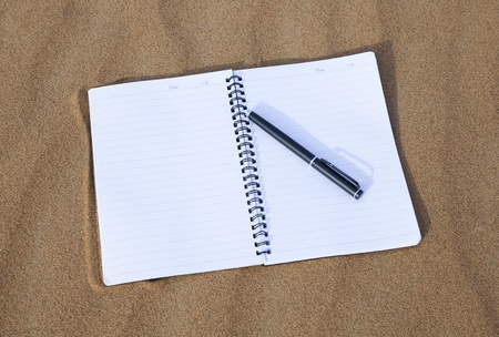 Notebook and pen isolated on desert Stock Photo - 17491906