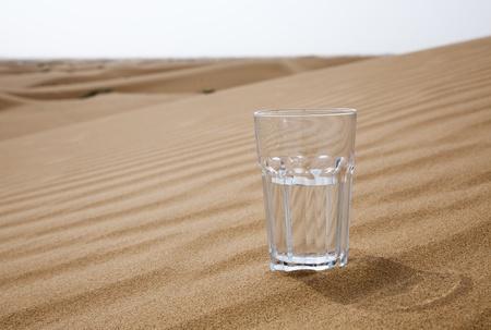 desert scenes: Glass of water half empty in desert