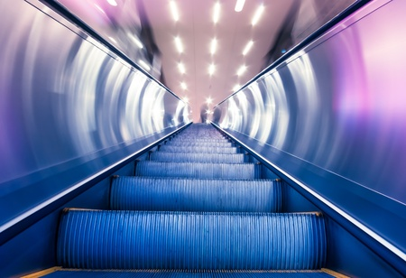 blur subway: escalator of the subway station in modern building Editorial