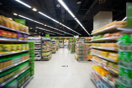 supermarket cash: Empty supermarket aisle