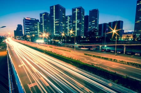 financial district: light trails on the modern city at dusk in beijing,China