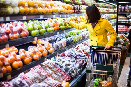 asian produce: Young woman shopping in the supermarket Stock Photo