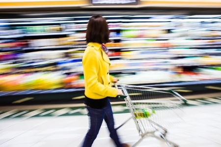 supermarket shelves: shopping at the supermarket,motion blur