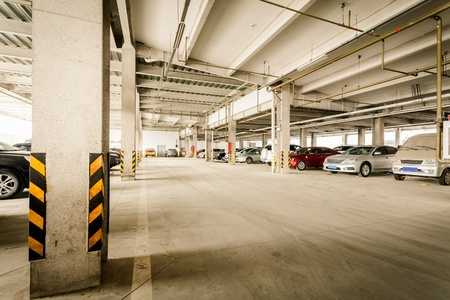 car parking: Parking garage, interior with a few parked cars. Editorial