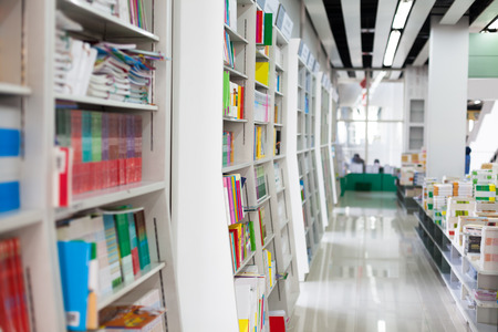 aisles: The aisles in a public library with shelves full of books Editorial