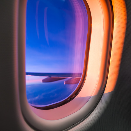 window view: Sky as seen through window of an aircraft Stock Photo