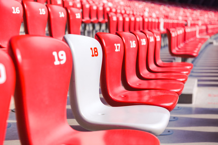 bleachers: Red chairs bleachers in large stadium Editorial
