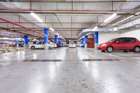 car parking: Parking garage, underground interior with a few parked cars