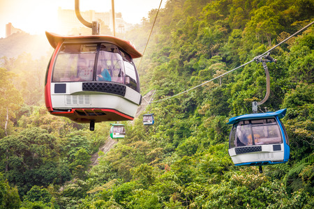 highlands: Aerial tramway moving up in tropical jungle mountains