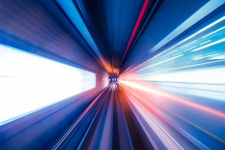 Abstract train moving in tunnel photo