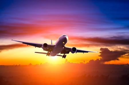 jetliner: Airplane in the sky at sunrise