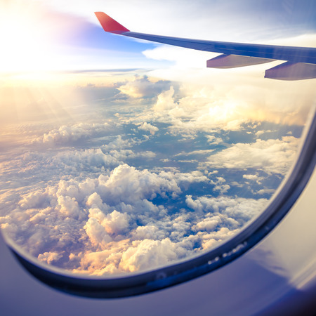 Clouds and sky as seen through window of an aircraft Stock Photo - 26573885