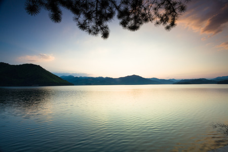 Tranquil lake under the sunset photo
