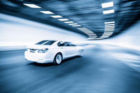 Interior of an urban tunnel with car,motion blur photo