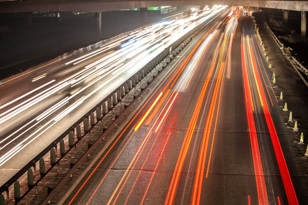 time lapse: Busy Night Traffic Motion Blur Stock Photo