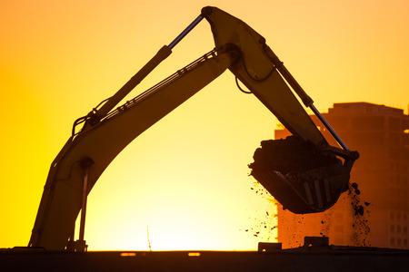 bulldozers: Closeup excavator at sunset Stock Photo
