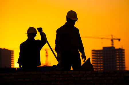 worker construction: silhouette of construction worker Stock Photo