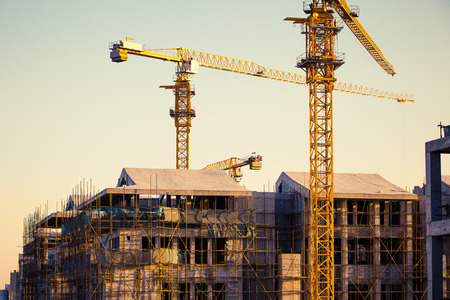commercial construction: Construction site with crane and building