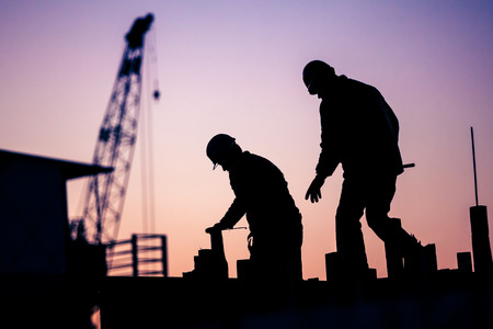 chinese people: silhouette of construction worker Stock Photo