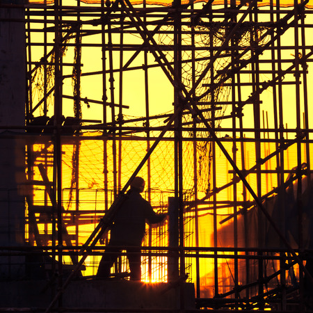 silhouette of construction worker 스톡 콘텐츠