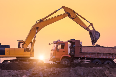heavy wheel excavator machine working at sunset Reklamní fotografie - 32635510