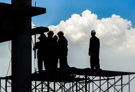 laborers: silhouette of construction worker Stock Photo