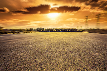 move ahead: motion blur of road at sunset
