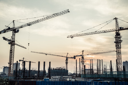 housing industry: silhouette of construction site Stock Photo