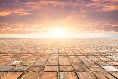 cobblestone street: By bricks tiles in sunset