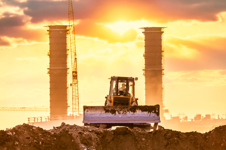 industry moody: Bulldozer in the building site
