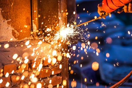worker cutting steel board using metal torch Stock Photo