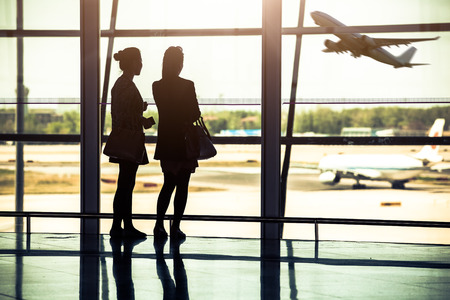 china people: Travelers silhouettes at airport,Beijing Stock Photo
