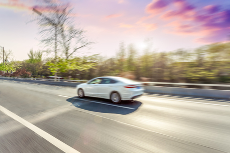 Car driving on road, motion blur Stok Fotoğraf