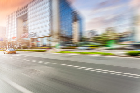 Car driving on road, motion blur Stock Photo