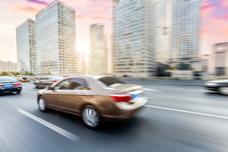 speeding car: Car driving on road, motion blur Stock Photo