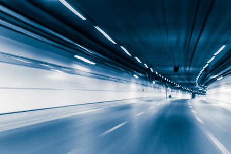 Blue color tunnel car driving motion blur