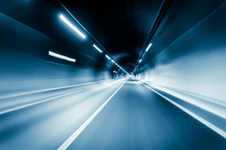 dark city: Blue color tunnel car driving motion blur