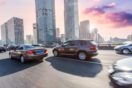 Car driving on road, motion blur Reklamní fotografie