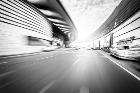 speed car: Car driving on road in city background, motion blur