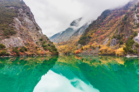 mountain and lake in fall in China Reklamní fotografie - 123024035