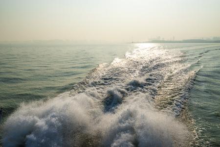 splash water at ship tail in sea
