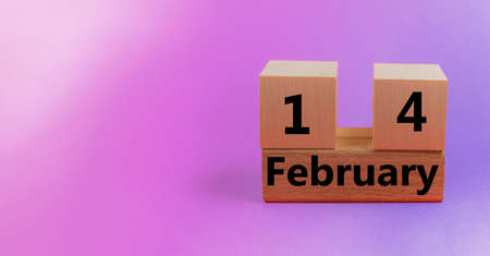 Gradient pink background with wooden block calendar with date February 14 with copy space and space for your text
