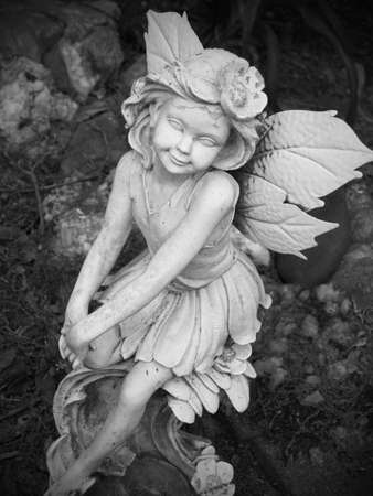 angle statue in flower garden