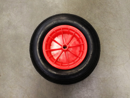 Wheel for garden cart, black rubber with plastic orange disc