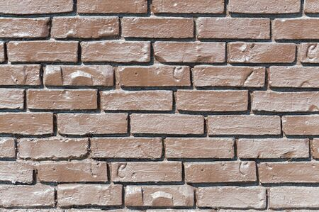 Brown brick wall. The brick is painted with clear lacquer. Background. Front view. Stok Fotoğraf