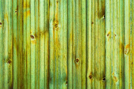 Wooden vertical green yellow boards. Abstract background. Front view