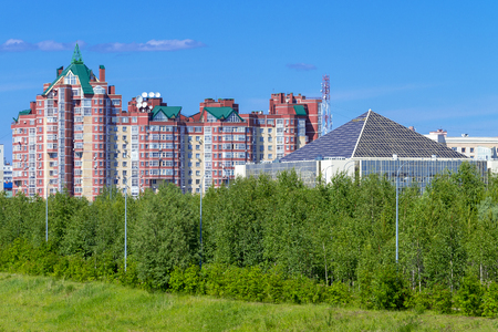 Street University and office building Tyumenenergo. Front View, Surgut, Russia - June 30, 2019 Editöryel