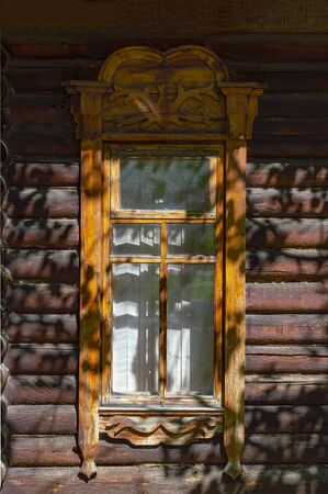 Window in a wooden log house. Front view. Stok Fotoğraf - 131437055