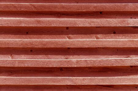 Horizontal brown boards and planks, fragment of the wall. Textured background. Front view. Stok Fotoğraf - 131246434